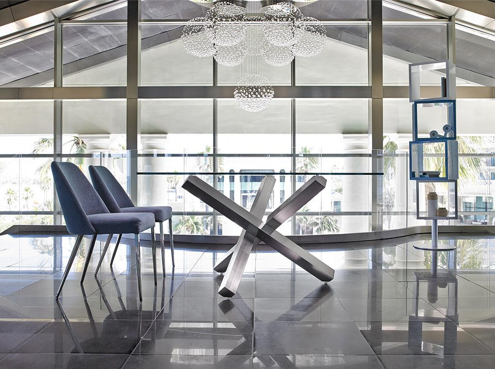Dining table with polished steel base