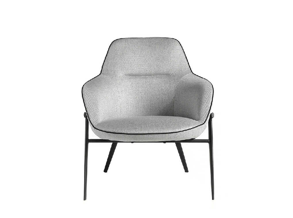 Confident armchair upholstered in fabric with piping
