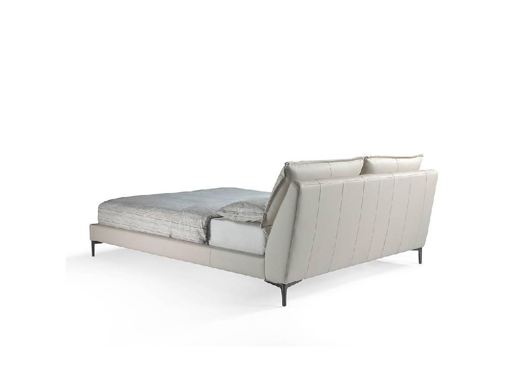 Cama tapizada con patas de pletina maciza de acero inoxidable