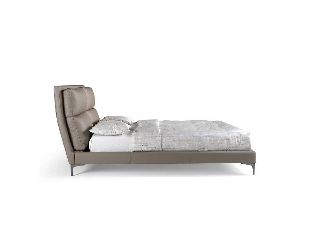 Bed upholstered in leatherette with cushions